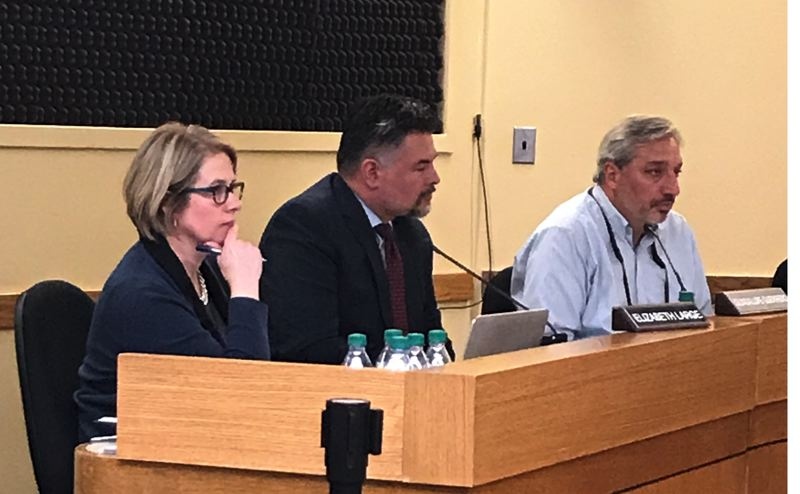 TRIBUNE PHOTO: SHASTA KEARNS MOORE - Interim General Counsel Liz Large (left) sits next to Superintendent Guadalupe Guerrero (center) and board member Mike Rosen at the April 10 board meeting.