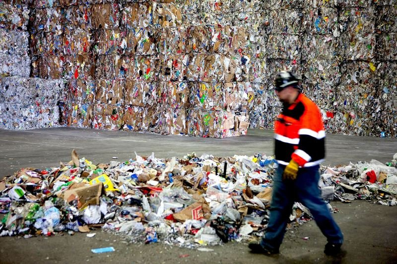 TRIBUNE FILE PHOTO - Bales of recyclables waiting to be sold are stored at a Far West Recycling facility in Hillsboro. The company has found some new buyers in Asia for its plastics and paper collected from Oregon curbsides.