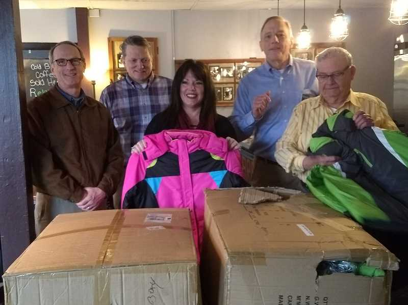 SUBMITTED PHOTO: DICK GOODWIN - Members of the Knights of Columbus get coats ready for donation to Transitional Youth, from left: Knight Dan Boone; Grand Knight Jon Brumbaugh; Rhona Mahl, executive director of Transitional Youth/Braking Cycles; Knight Phil Barr; and Knight George Vogelsang.