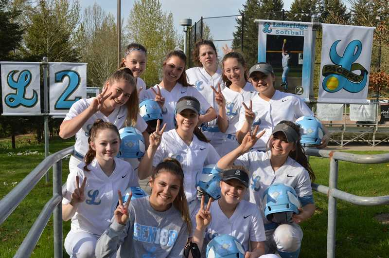 SUBMITTED PHOTO: GAYLE MICKEY - Lakeridge softball players hold up two fingers to represent the jersey number of Nina Heidgerken, who played for the Pacers during her freshman and sophomore years. Banners at the field also honor the 18-year-old, who died March 31.