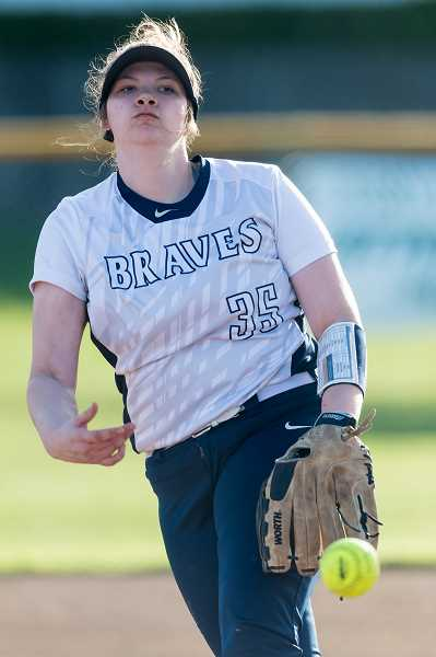 STAFF PHOTO: CHRISTOPHER OERTELL - Banks' Michaela Shaw hurls a pitch during the Braves' game against Scappoose April 10 at Banks High School.