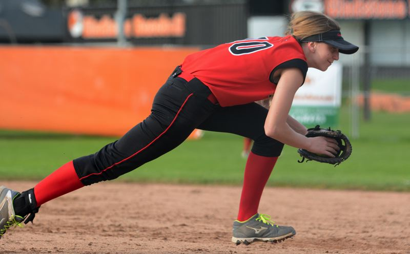 OUTLOOK PHOTO: DAVID BALL - Corbetts Faith McQueen dives toward first base to get the final out of the sixth inning.