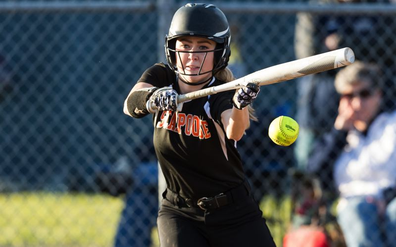 SPOTLIGHT PHOTO: CHRIS OERTELL - Scappoose's Megan Dews bunts during her team's 8-6 Cowapa League loss to Banks at Banks High School on Tuesday.