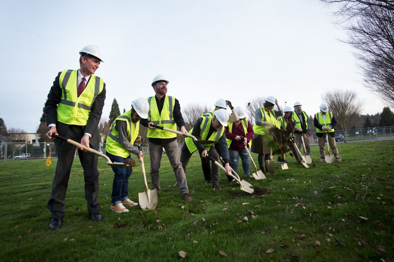 TIMES PHOTO: JAIME VALDEZ - Tigard-Tualatin School District Superintendent Ernie Brown leads supporters in the groundbreaking of the Durham Education Center recently.