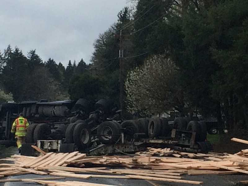 PIONEER PHOTO: CINDY FAMA - A flatbed trailer tipped and scattered lumber across the road, closing Union Mills on Thursday, April 12.