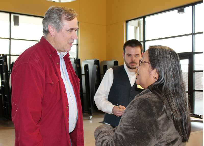 HOLLY M. GILL - Sen. Jeff Merkley, left, visits with Julie Quaid, a member of the Warm Springs Community Action Team Board of Directors, while staff member B.J. Westlund takes notes.