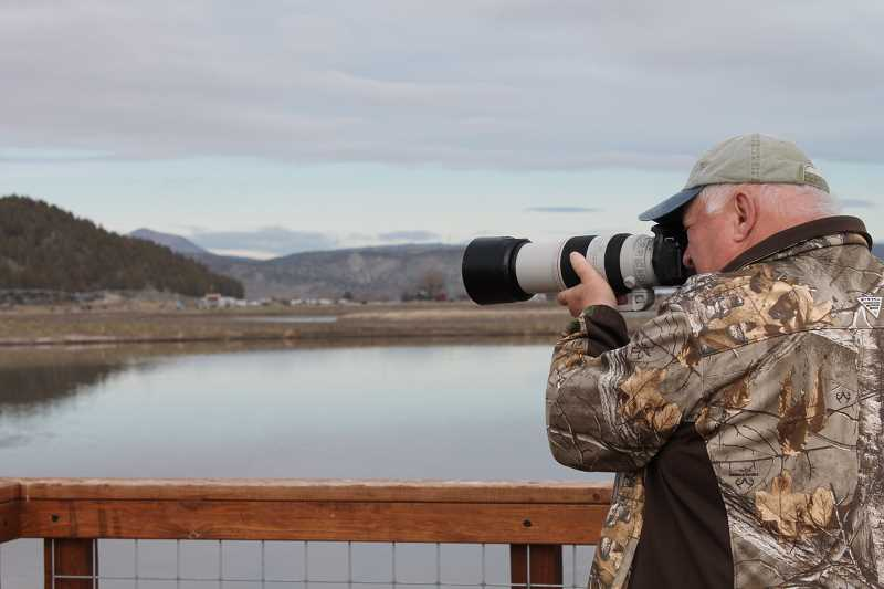 CHRISTINA LILIENTHAL - Chuck Gates spots different bird species that visit the Crooked River Wetlands Complex in Prineville.
