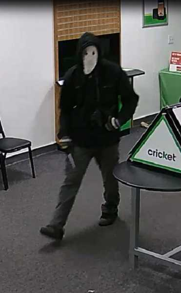 CONTRIBUTED PHOTO: MULTNOMAH COUNTY DISTRICT ATTORNEYS OFFICE - Surveillance footage captured the Feb. 24 armed robbery at Cricket Wireless, 1 N.E. 181st Ave.