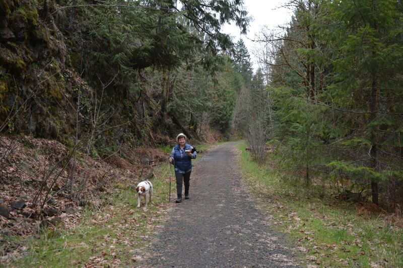 SPOTLIGHT PHOTO: COURTNEY VAUGHN - JJ Duehren and her dog, Minnie, often hike the Crown Zellerbach Trail together. Duehren is an avid trail enthusiast and takes it upon herself to make sure citizens have updated information about the CZ Trail.