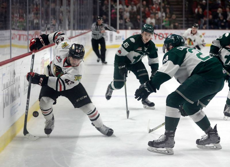 TRIBUNE PHOTO: JONATHAN HOUSE - Skyler McKenzie of the Portland Winterhawks tries to get past the Everett Silvertips defense during Thursday night's Game 4 of the WHL Western Conference semifinals at Moda Center.