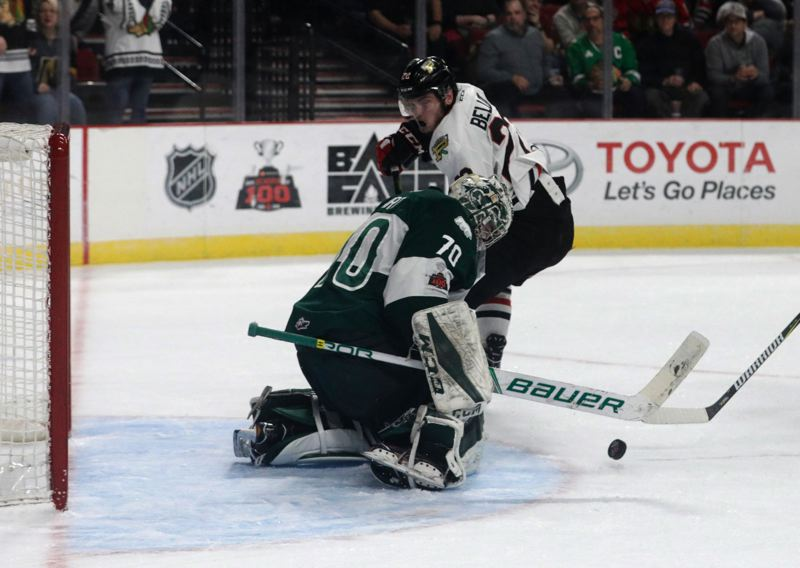 TRIBUNE PHOTO: JONATHAN HOUSE - Everett goalie Carter Hart moves to stop a shot by Portland's Kieffer Bellows as the Silvertips win Game 4 against the Winterhawks on Thursday night at Moda Center. The 3-2 victory gave Everett a 3-1 series lead, with Game 5 Friday night at Everett.