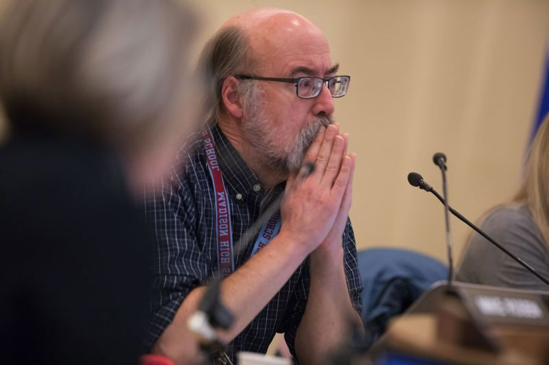 TRIBUNE FILE PHOTO - Board member Scott Bailey at a recent meeting. Bailey was concerned Tuesday night over the lack of money to pay for needed improvements to buildings to implement the board's middle school plan.