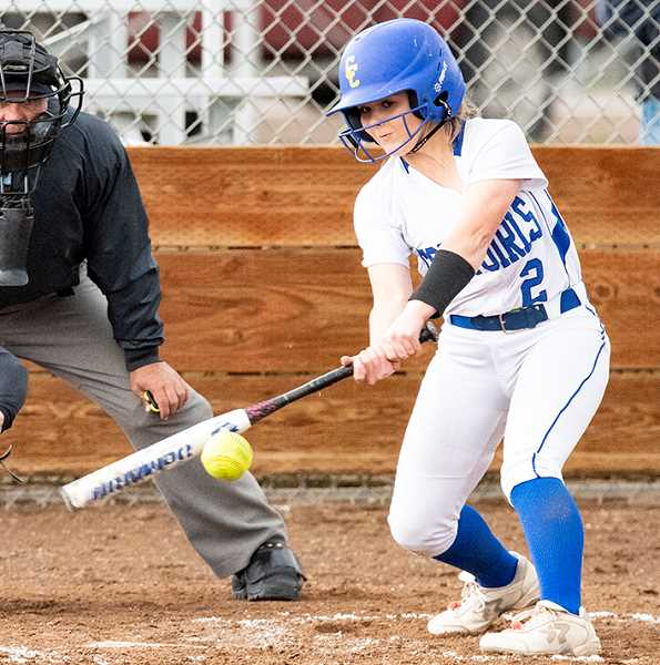 LON AUSTIN/CENTRAL OREGONIAN - Berkley Puckett drives a single during the Cowgirls' second victory over Corbett Wednesday afternoon. Puckett plays shortstop for the Cowgirls, who are undefeated in league.