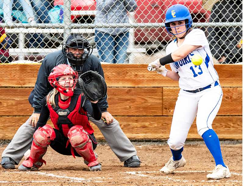 LON AUSTIN/CENTRAL OREGONIAN - Kalyn Martinez starts her swing in game two of the Cowgirls' doubleheader against Corbett Wednesday afternoon. Martinez hit a home run on the pitch, one of two for the Cowgirls on the day, along with 11 other extra base hits as the Cowgirls blasted the Cardinals 11-0 and 15-1. With the wins, the Cowgirls are now in first place in the Tri-Valley Conference with a 4-0 record.