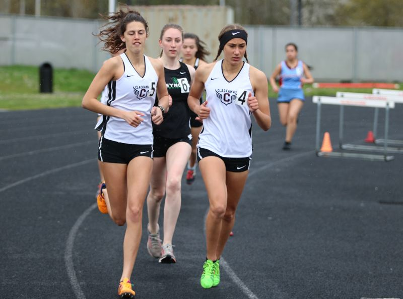 PAMPLIN MEDIA PHOTO: JIM BESEDA - Clackamas' Alexa Hayes (5) and Brooklyn James (4) set the early pace in the girls' 1,500-meter run at Wednesday's Mt. Hood Conference double-dual meet with Centennial and Reynolds.