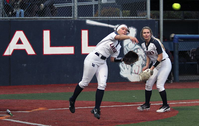 REVIEW PHOTO: MILES VANCE - Lake Oswego third baseman Vivian Rittenour makes a throw to first during her team's 5-4 home win over West Linn on Thursday at Lake Oswego High School.