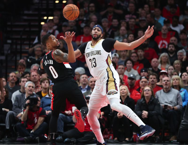 TRIBUNE FILE PHOTO: JAIME VALDEZ - The two biggest stars in the Portland-New Orleans first-round series, Damian Lillard (left) of the Blazers and Anthony Davis of the Pelicans, go at it in a regular-season game.