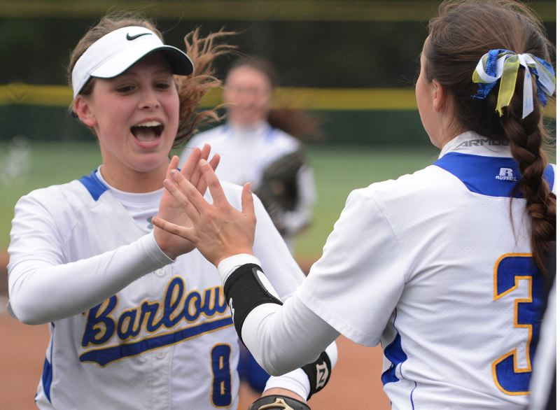 OUTLOOK PHOTO: DAVID BALL - Barlow shorstop Sammie Pemberton slaps a high five with pitcher Alexa Geary after coming up with the final out in the sixth inning.