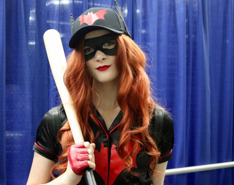 TRIBUNE PHOTO: ZANE SPARLING - Alice Leask, a resident of Camas, Washington, poses for a photo at the Wizard World Comic Con in Portland. The 17-year-old is dressed as Batgirl.