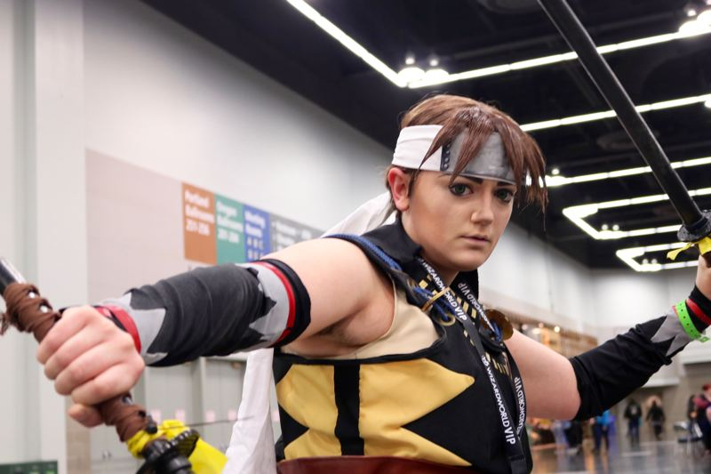TRIBUNE PHOTO: ZANE SPARLING - Syndey Child, of Vancouver, Washington, poses for a photo at Wizard World Comic Con on Saturday, April 14 in Portland. The 21-year-old is dressed as Toudou Heisuke, a Japanese samurai who appears in the video game Hakuoki.