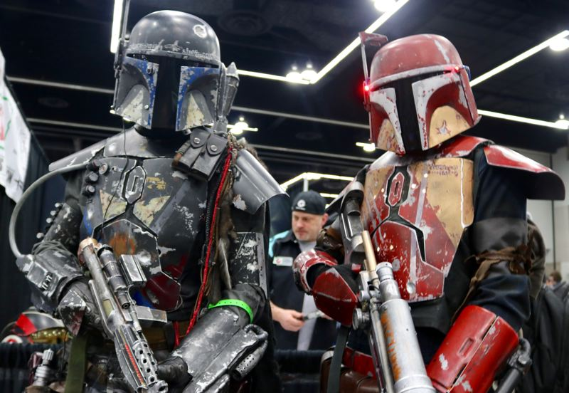TRIBUNE PHOTO: ZANE SPARLING - FROM LEFT: Wesley and Jeremiah Stirn, both of North Albany, pose for a photo at the Wizard World Comic Con on Saturday, April 14 in Portland. Both are dressed as Mandalorian warriors from the 'Star Wars' universe.