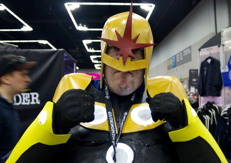 TRIBUNE PHOTO: ZANE SPARLING - Harry Jensen poses for a photo at the Wizard World Comic Con in Portland at the Oregon Convention Center. The Hillsboro resident is dressed as Nova from the movie 'The Guardians of the Galaxy.'