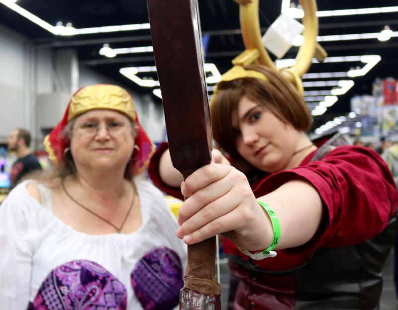 TRIBUNE PHOTO: ZANE SPARLING - FROM LEFT: Michele and Talia Gant poses for a photo during the Wizard World Comic Con on Saturday, April 14 in Portland. The Vancover residents are dressed as Myriam and Leah from the video game 'Diablo.'