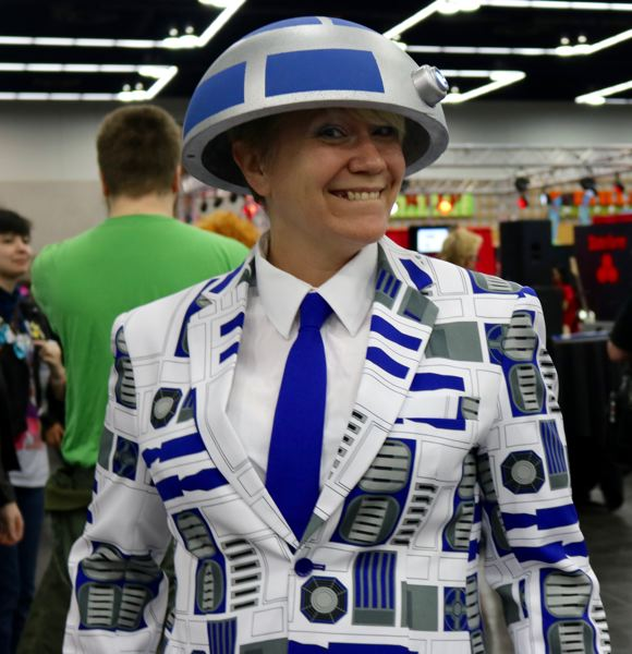 TRIBUNE PHOTO: ZANE SPARLING - Dott Campo, a Woodburn resident, poses for a photo at Wizard World Comic Con on Saturday, April 14 in Portland. The 42-year-old is wearing an R2D2-inspired costume.