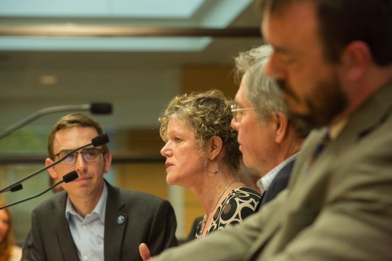 PHOTO: JOSHUA MANUS, METRO - Economists met at Metro's Council Chambers Wednesday 11 April, 2018, to give elected officials in the Portland metro region a sense of their predictions for economic and population growth in the next 20 years.  (L-R) Craig Beebe, project Manager Metro (moderator); Sheila Martin, director, Portland State University Institute of Portland Metropolitan Studies; Tom Potiowsky, director, PSU Northwest Economic Research Center and Bill Reid, principal, PNW Economics.