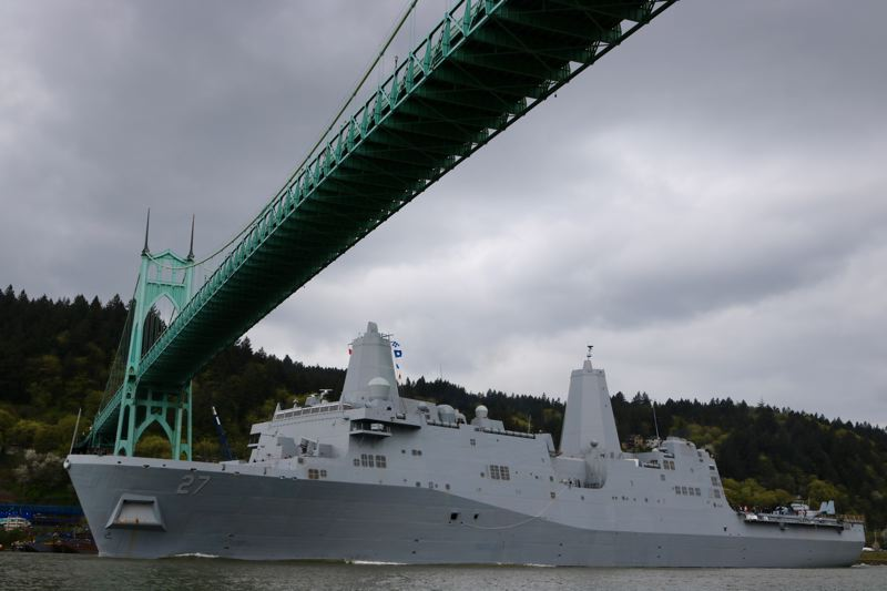 TRIBUNE PHOTO: ZANE SPARLING - The USS Portland sails along the Willamette River underneath the St. Johns Bridge shortly after 3 p.m. on Saturday, April 14.