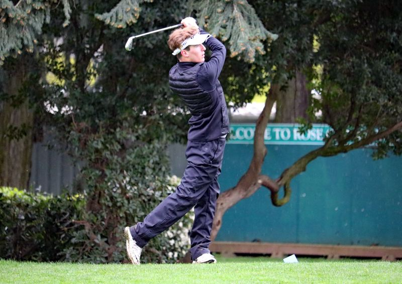 PAMPLIN MEDIA PHOTO: JIM BESEDA - Clackamas' Nick Lasko, watching his tee shot at the par-3 fifth hole, finished at 1-over-par 73 with three birdies and a hole-in-one on the 12th hole at Rose City Golf Course Thursday.