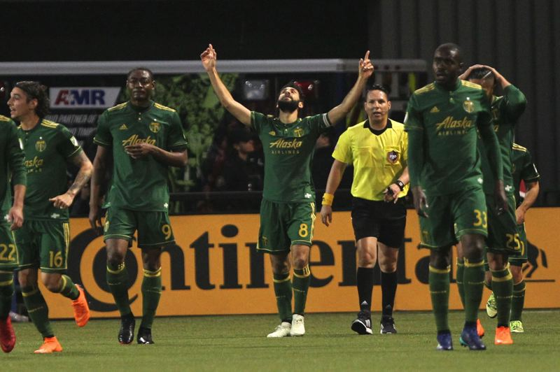 TRIBUNE PHOTO: JAIME VALDEZ - Diego Valeri (center) of the Portland Timbers celebrates a goal in Saturday night's 3-2 victory over Minnesota United.