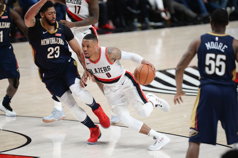 TRIBUNE PHOTO: JOSH KULLA - Damian Lillard of the Trail Blazers gets a step on New Orleans center Anthony Davis during Game 1 of the NBA playoffs for both teams.