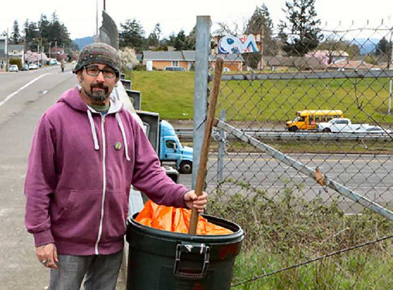 DAVID F. ASHTON - Working along I-205, primarily in the Lents neighborhood, Gary Mack sets out on another trash-picking-up mission.