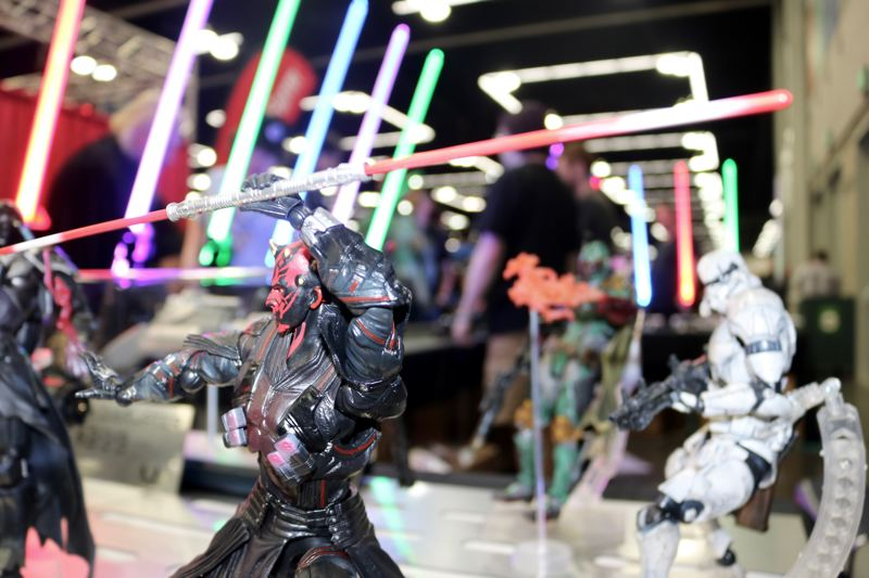 TRIBUNE PHOTO: ZANE SPARLING - Lightsabers and figurines from the 'Star Wars' universe were on display at Wizard World Comic Con.