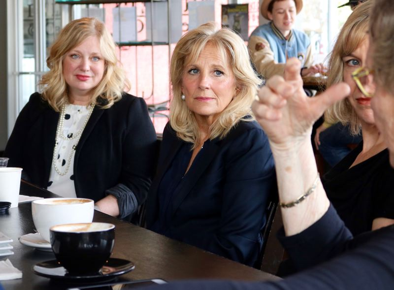 TRIBUNE PHOTO: ZANE SPARLING - FROM LEFT: Oncology social worker Krista Nelson sits next to Dr. Jill Biden durng a listening session in Portland on Friday, April 14 as part of the Biden Cancer Initiative.
