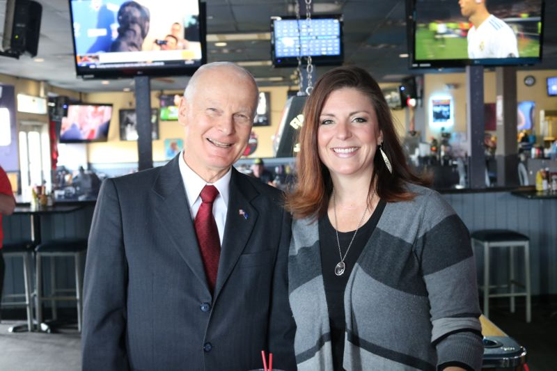 OUTLOOK PHOTO: ZANE SPARLING - Secretary of State Dennis Richardson poses for a photo with Stayce Blume inside her establishment, Skyland Pub, on Wednesday, April 11, in Troutdale.