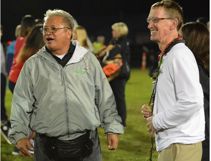 OUTLOOK PHOTO: DAVID BALL - Coaches Wendell Say and Chris Knudsen, right, meet for a handshake at midfield after a game in 2016. The former teammates at Linfield squared off when Say decided to bring his Hawaii-based team out of Aiea High School to the mainland.