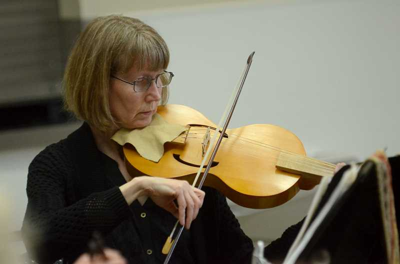 Gail Neuman plays the Vielle, a stringed instrument from the the Medieval period.