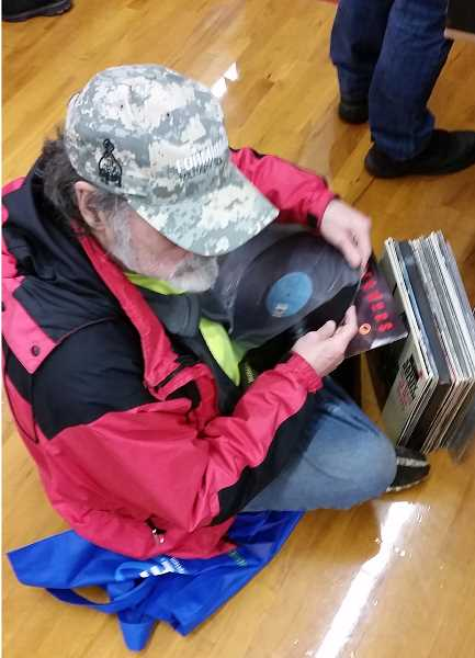 JOHN BAKER - Visitors to the Record Bonanza sometimes had to get creative to look through record stacks.