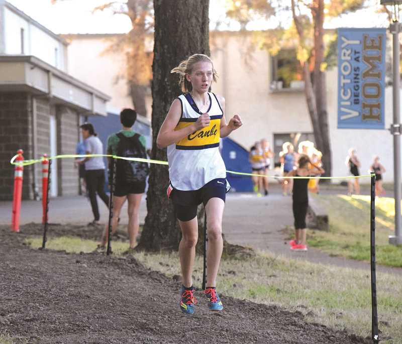 ARCHIVE PHOTO - Canby sophomore Izabela Kacalek bested the 15 year old 3,000 meters record time in her very first time racing the event. Kacalek is Canby's top distance runner, and hopes to continue to improve over the course of the season.