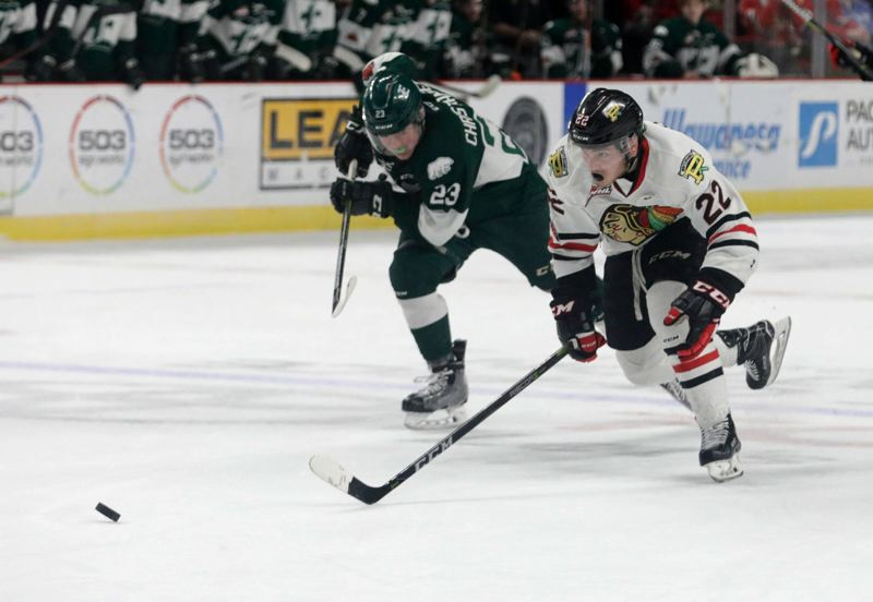 TRIBUNE PHOTO: JONATHAN HOUSE - Portland's Kieffer Bellows charges forward, only to be stopped by Everett goaltender Carter Hart, in the second period of the pivotal Game 4, which the Silvertips won, 3-2, with two late goals at Moda Center.