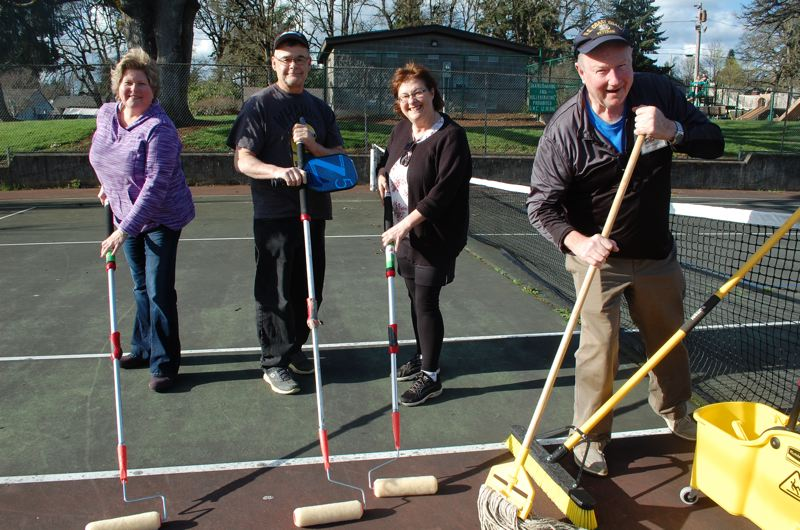 PHOTO BY: RAYMOND RENDLEMAN - Getting ready for the renovation of tennis courts in Gladstone are, from left, Teena Hall, Bill and Lisa Preble, and Tom Widden.