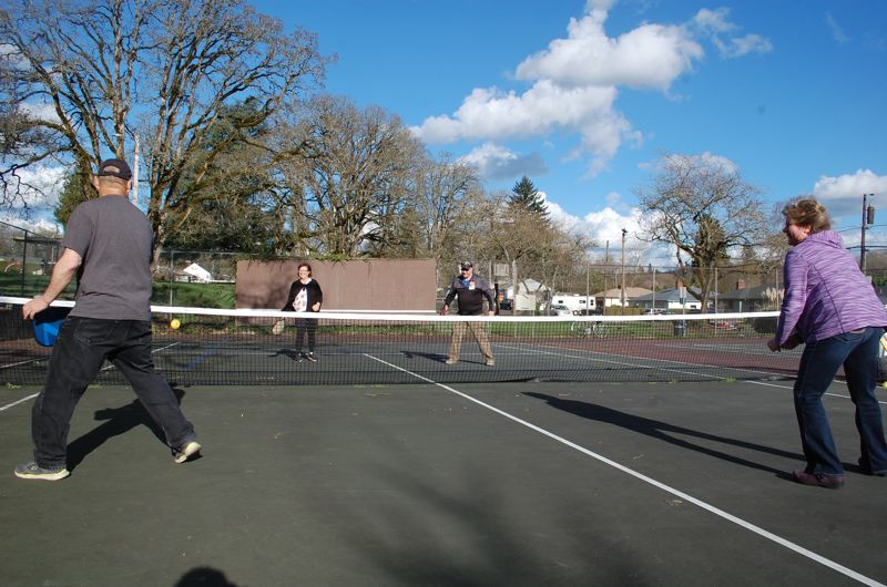 PHOTO BY: RAYMOND RENDLEMAN - Pickleball can still be played, if not easily, using higher nets on the currently crumbling tennis courts at Max Patterson Park in Gladstone.