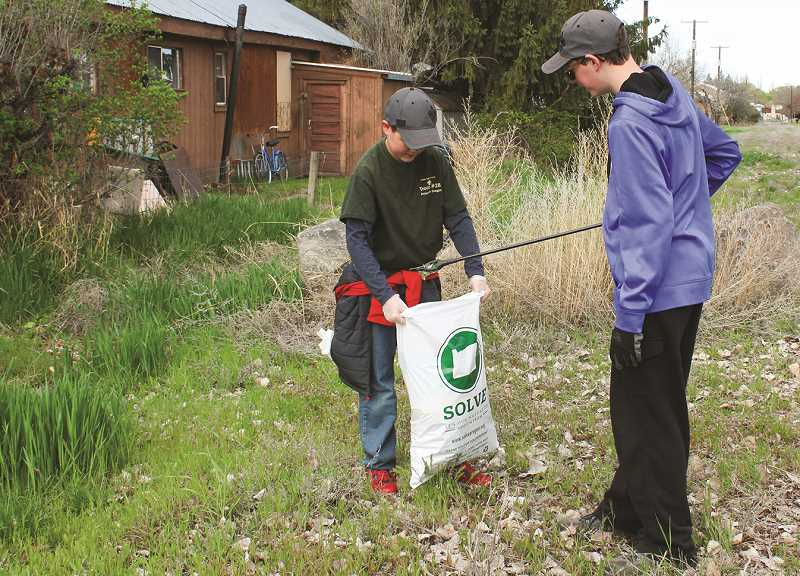 CENTRAL OREGONIAN FILE PHOTO - Last year, members of Boy Scout Troop 28 helped pick up litter during the Prineville Clean-up Day, which Crook County Parks and Recreation hosts in conjunction with SOLVE and Earth Day each spring.