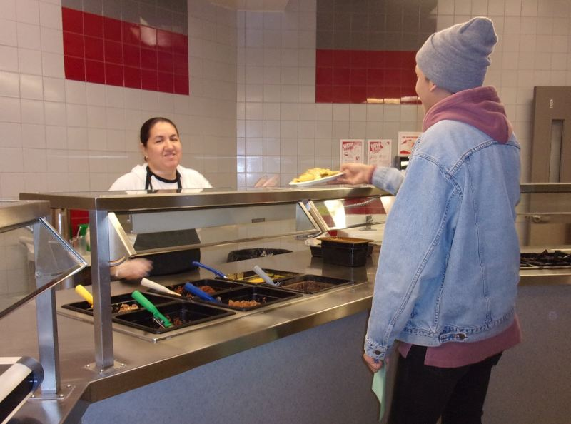 PHOTO COURTESY: MICHAEL CLARK - Laura Ferreyra, a food service worker at Oregon City High School, works to provide great customer service.