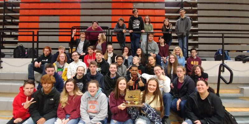 Gladstone High School's band is pictured with its League trophy.