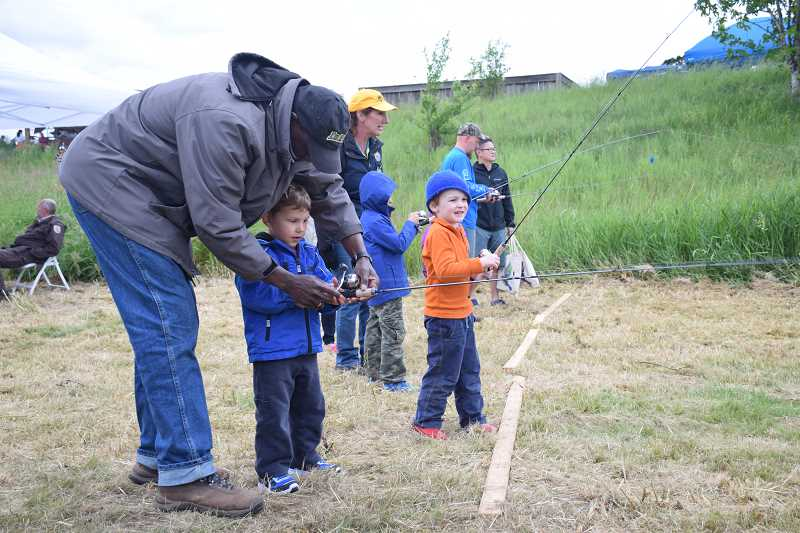 COURTESY: PAM FARRIS - Kids learn how to cast a fishing line at the Tualatin River National Wildlife Refuge.
