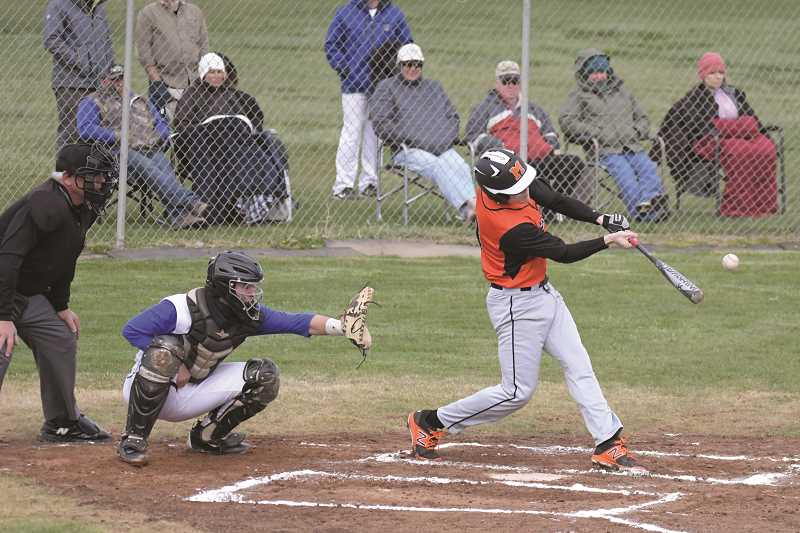 PAMPLIN MEDIA GROUP PHOTO: LON AUSTIN - Molalla senior Braden Hibbs crushes a pitch from Crook County, and helped get his team the W against the top team in the league, 9-6.