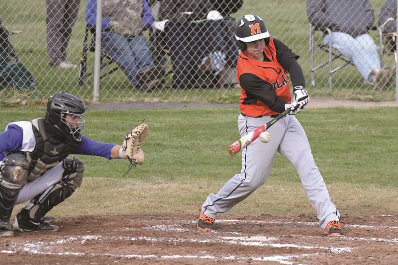 PAMPLIN MEDIA GROUP PHOTO: LON AUSTIN - Molalla sophomore Damian Pingo connects on a swing that would hit Crook County's second baseman in the face and force him from the game.